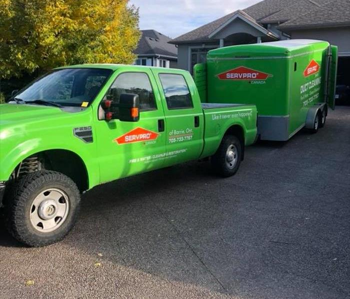 SERVPRO of Barrie's business truck and trailer in a local home's driveway while we perform repair work inside.